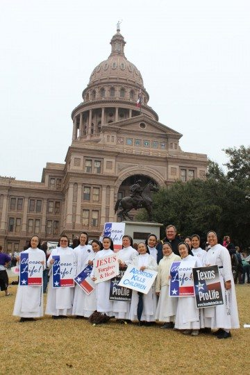 "A group of nuns pose in fron of the Capitol to support the ""Choose life"" initiative."