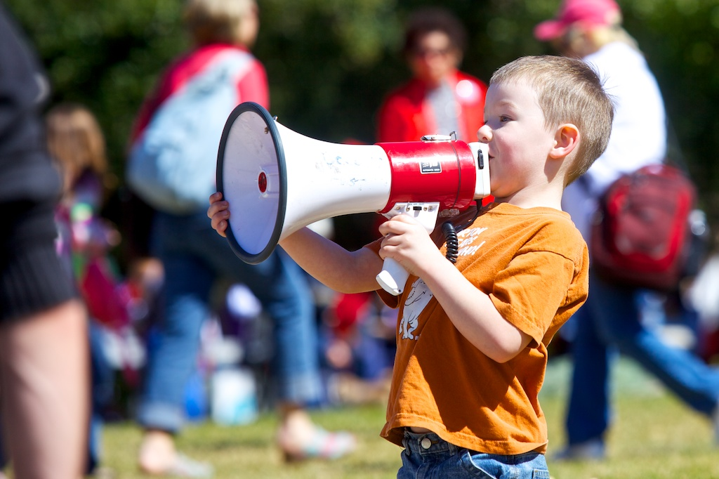 "A boy yells, ""Save our schools!"" through a megaphone at the Save Texas Schools rally."