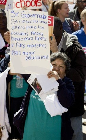 "Woman at the Save Texas Schools Rally holds up her sign. Translated from Spanish: ""Mr. Governor/we need more/ money for the schools Now/Money for books/and For teachers/for better education!"""