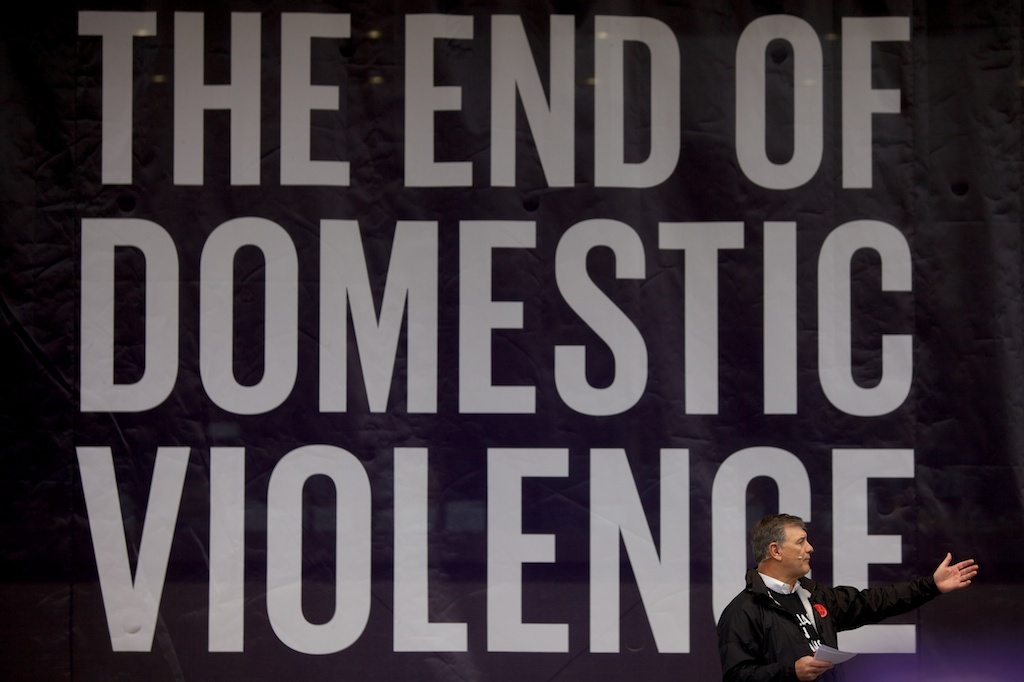 Dallas Mayor Mike Rawlings speaks at the anti-domestic violence rally Saturday.