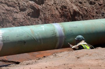A TransCanada employee works on a section of the Keystone XL pipeline near Winnsboro last year.