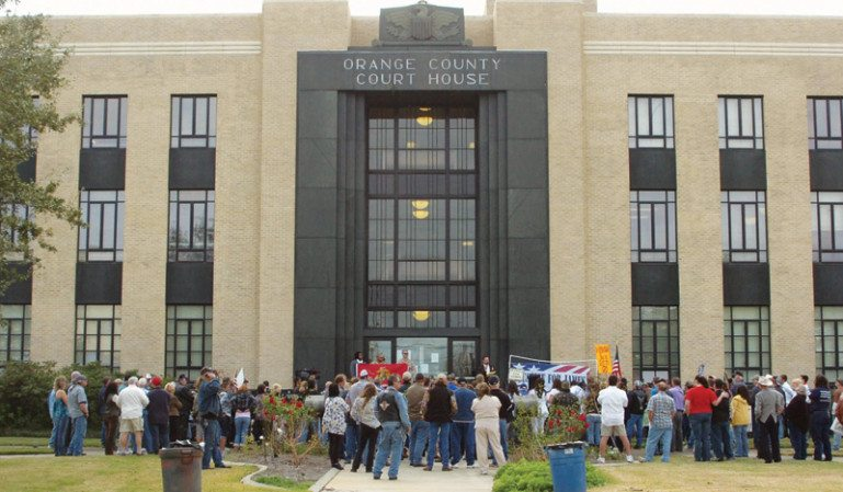 """Military veterans and James Whitehead's family and friends rallied at the Orange County Courthouse in December 2010 demanding """"Justice for James."""""""