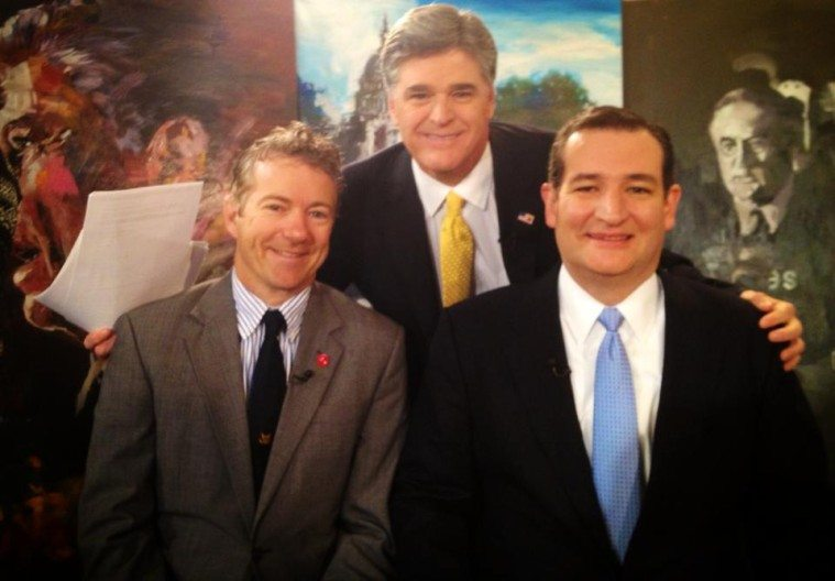 Kentucky Senator Rand Paul, left, and Texas Senator Ted Cruz, right, pose with Sean Hannity.