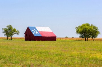 Photo illustration of a communist Texas barn.