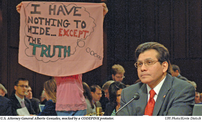 Alberto Gonzalez mocked by a CODEPINK protester.