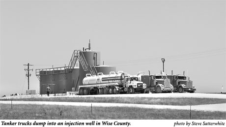 Tanker trucks dumping into an injection well