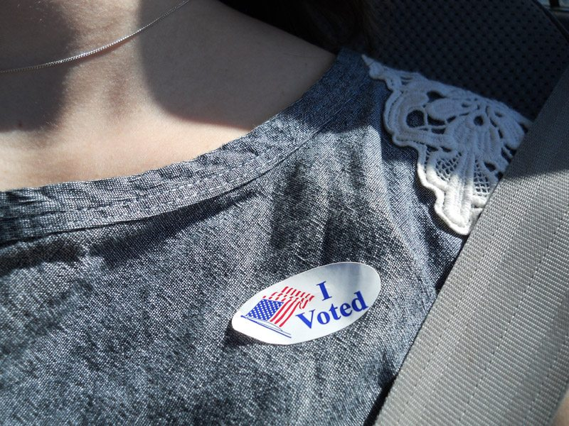 "Writer Emily Mathis displays her ""I voted"" sticker."
