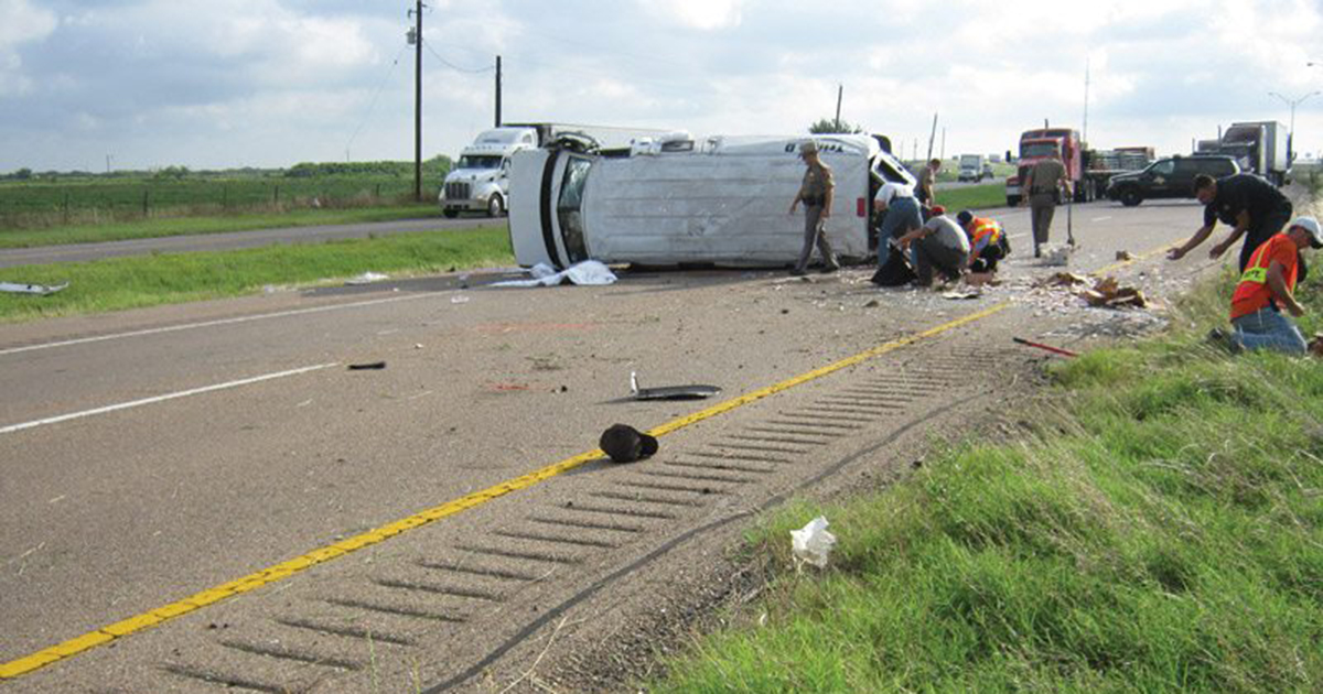 The scene after the wreck of a Triple D Security van on U.S. 59 outside Edna.