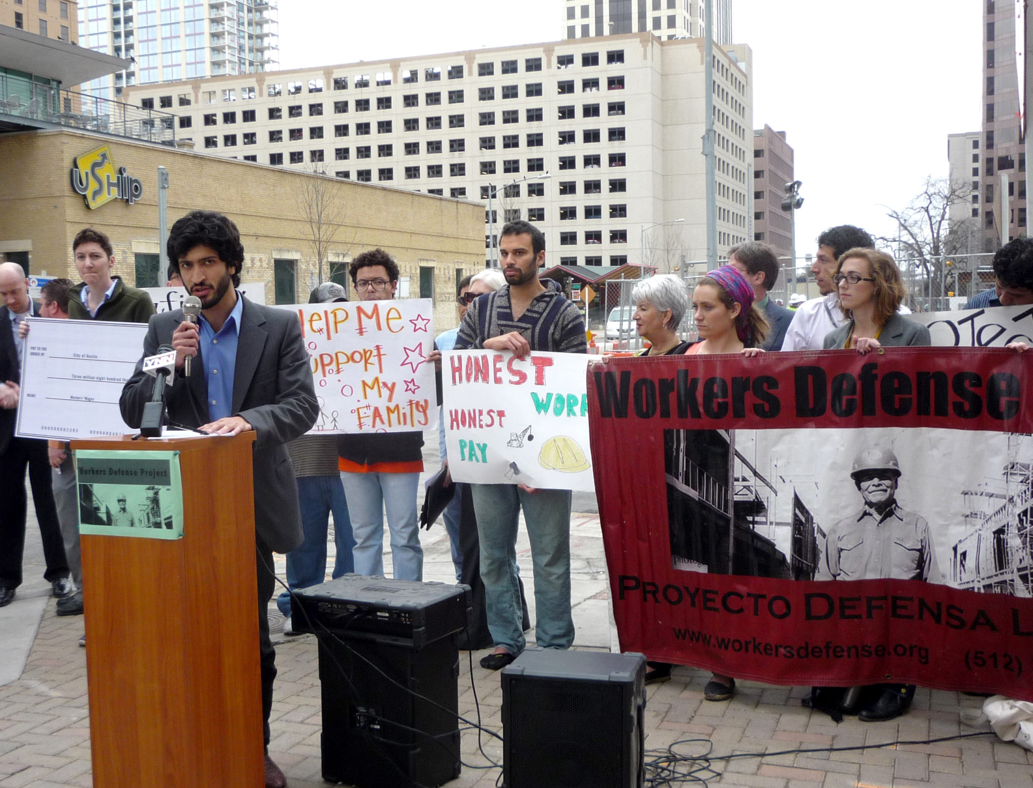 Workers Defense Project Business Liaison Greg Casar urges reform of Austin's incentive-giving system in front of the JW Marriott construction site in downtown Austin.