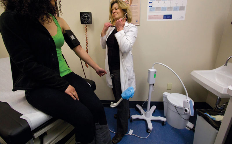 A patient gets her blood pressure checked at the Waco Planned Parenthood.