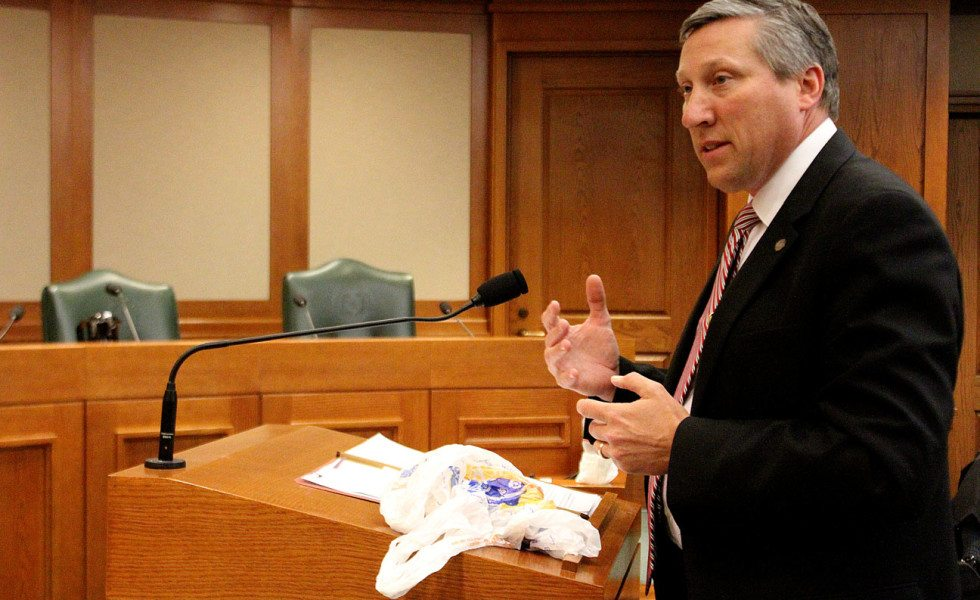 Rep. Drew Springer (R-Muenster) explains his plan to outlaw plastic bag bans Wednesday. To help his case, he brought some plastic bags.
