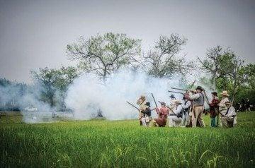 Reenactors skirmish outside Presidio La Bahia near Goliad.