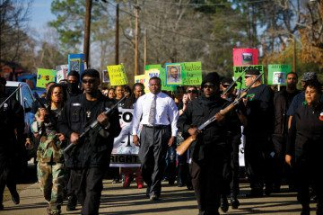 Quanell X leads a march past Hemphill's town square, calling for justice for Alfred Wright.