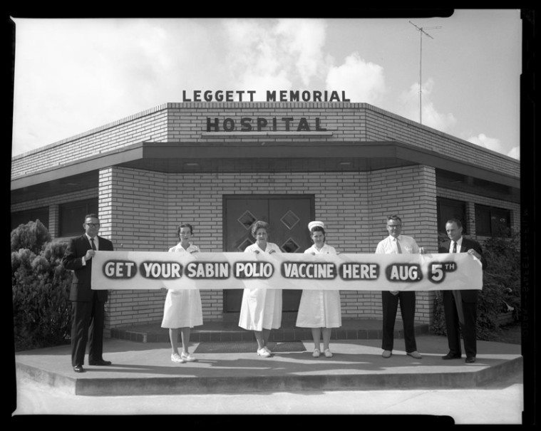 Vaccination campaigns all but eradicated troublesome diseases like polio and whooping cough. Leggett Memorial Hospital employees hold a banner announcing the arrival of the polio vaccine in Cleveland, Texas, 1962.