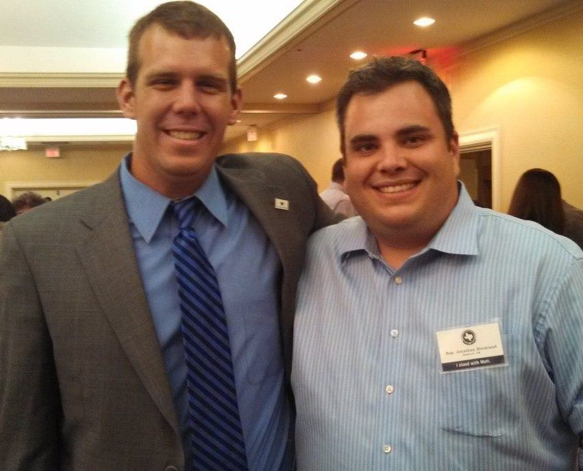 Philip Eby, left, with state Rep. Jonathan Stickland, posing before the war.