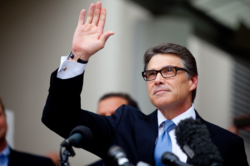 Rick Perry speaks outside the Travis County courthouse in 2014.