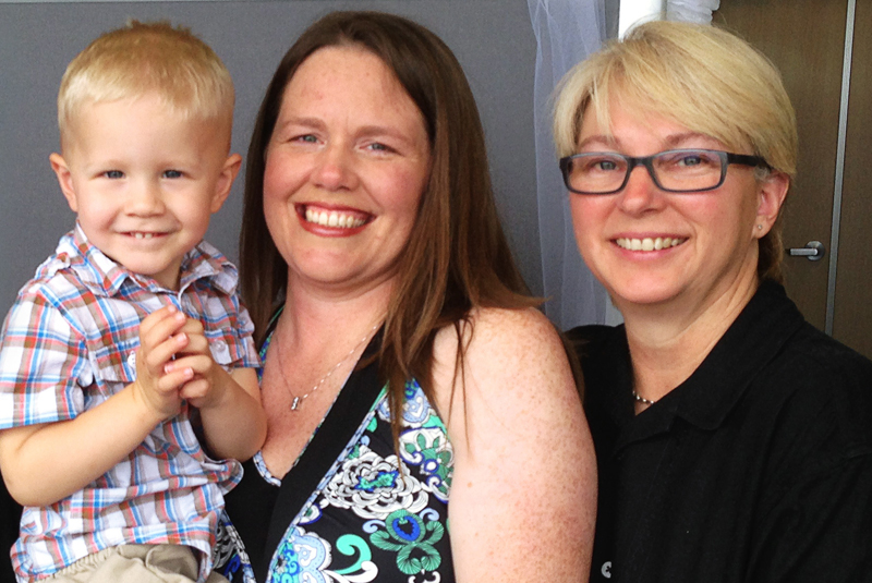 Aimee Wilson (center) and Connie Wilson (right) with their son Aidyn.