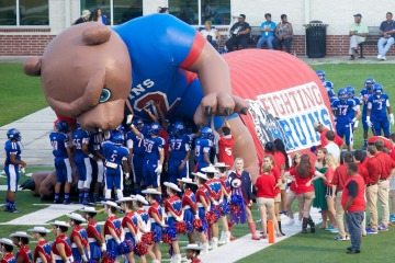 Beaumont's West Brook High School Bruins wait to take the field on homecoming night 2014.