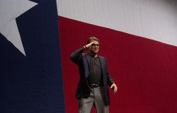 Perry salutes the crowd during Greg Abbott's victory party on election night, 2014.