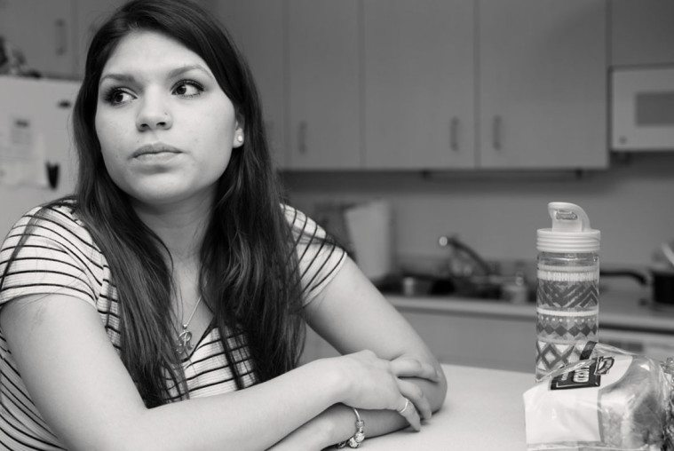 Reyna Mondragon in the kitchen of her student housing apartment in South Austin.