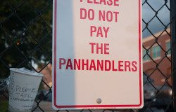 'Please do not pay the panhandlers' sign.
