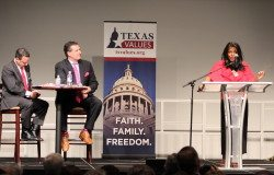 Democratic House candidate Denise Hamilton spoke Monday night during a forum at Prestonwood Baptist Church in Plano as moderators Dan Panetti, worldview director at Prestonwood Christian Academy, and Texas Values President Jonathan Saenz look on.