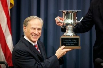 Governor Greg Abbott accepting the <i>Site Selection</i> Governor's Cup in March 2015.