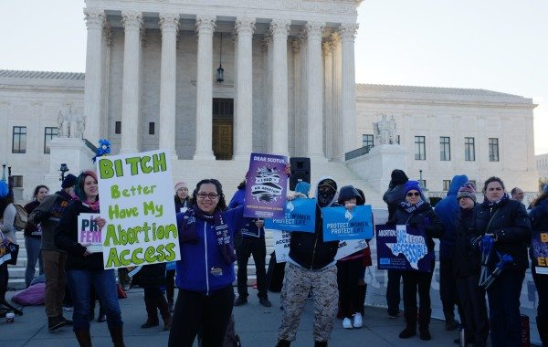 Protesters gather outside the U.S. Supreme Court as judges consider oral arguments in the Texas House Bill 2 abortion case, Whole Woman's Health v. Hellerstedt.