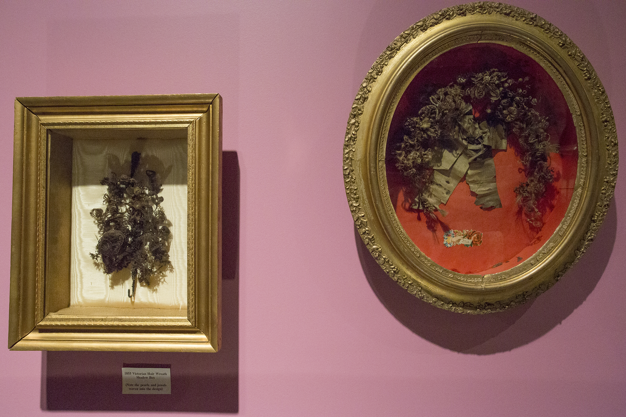 "Lightboxes filled with decorations made from human hair of the deceased, on display in the ""19th Century Mourning"" exhibit at the National Museum of Funeral History in Houston."