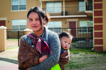 Par Meng and her toddler, Peter Lien, are Burmese refugees who've lived in Amarillo for two years. Now, state leadership wants more input into how refugees are settled across the state.