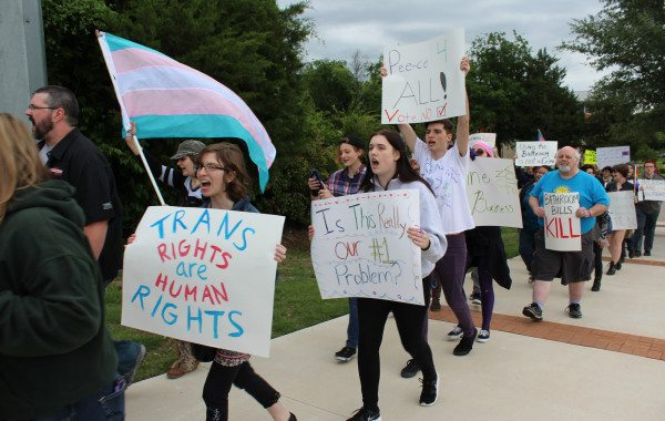 About 100 LGBT Texans, supporters and allies marched outside Rockwall City Hall Monday night to protest the mayor's proposal to criminalize some trans people for using public restrooms. Bathroom ordinance