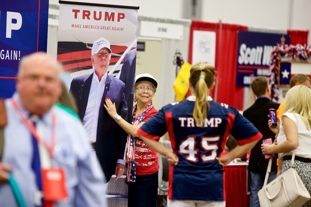 A Donald Trump supporter with a photo of the man