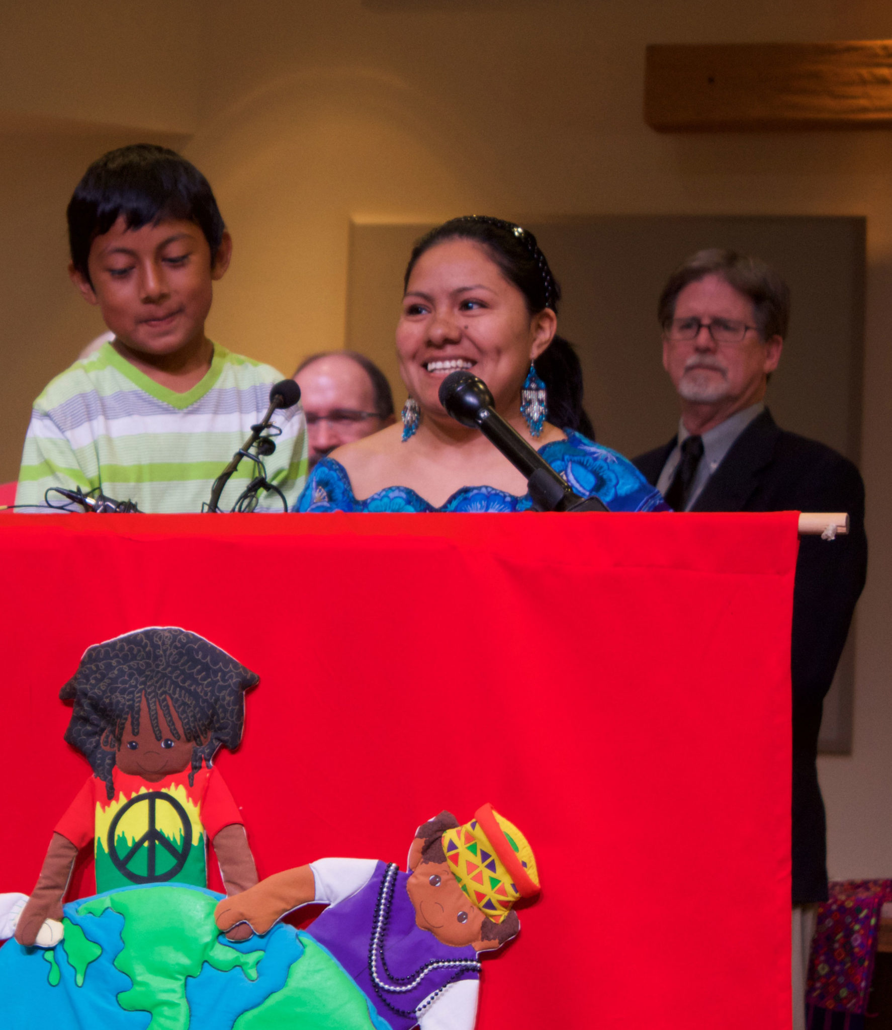 Hilda Ramirez with son, Ivan, and Alejandro Caceres of Grassroots Leadership during Tuesday's Press Conference at St. Andrew's Presbyterian Church of Austin