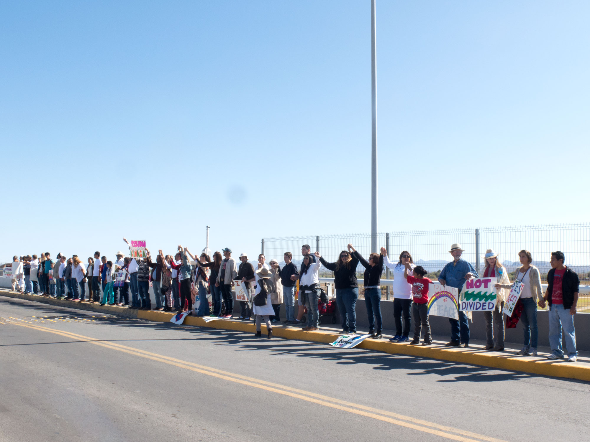 West Texans and Ojinaga, Mexico residents hold hands across the international bridge in a show of mutual solidarity.