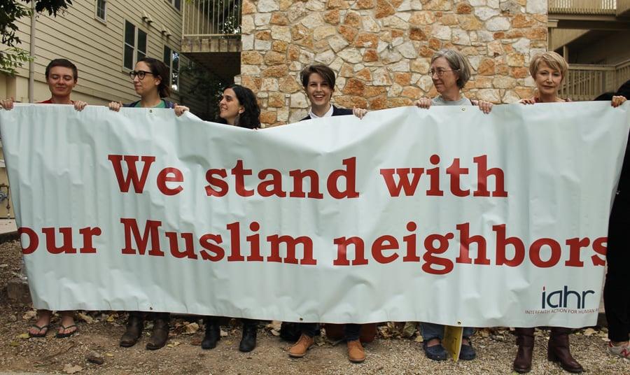 Demonstrators hold banner