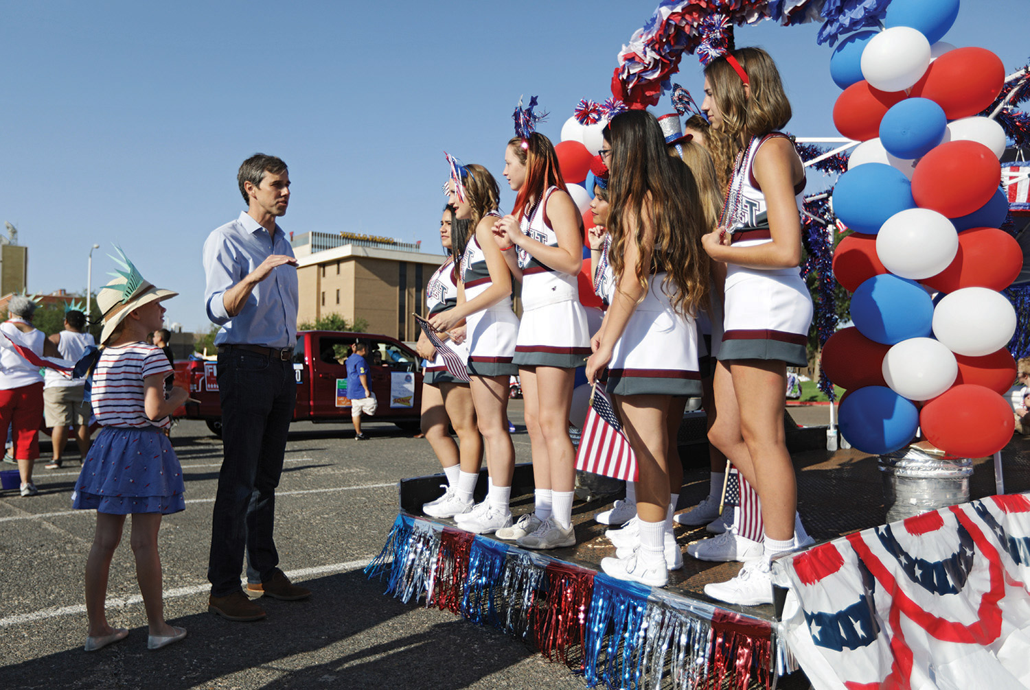 O'Rourke talks to cheerleaders from Roosevelt High School with his daughter Molly.