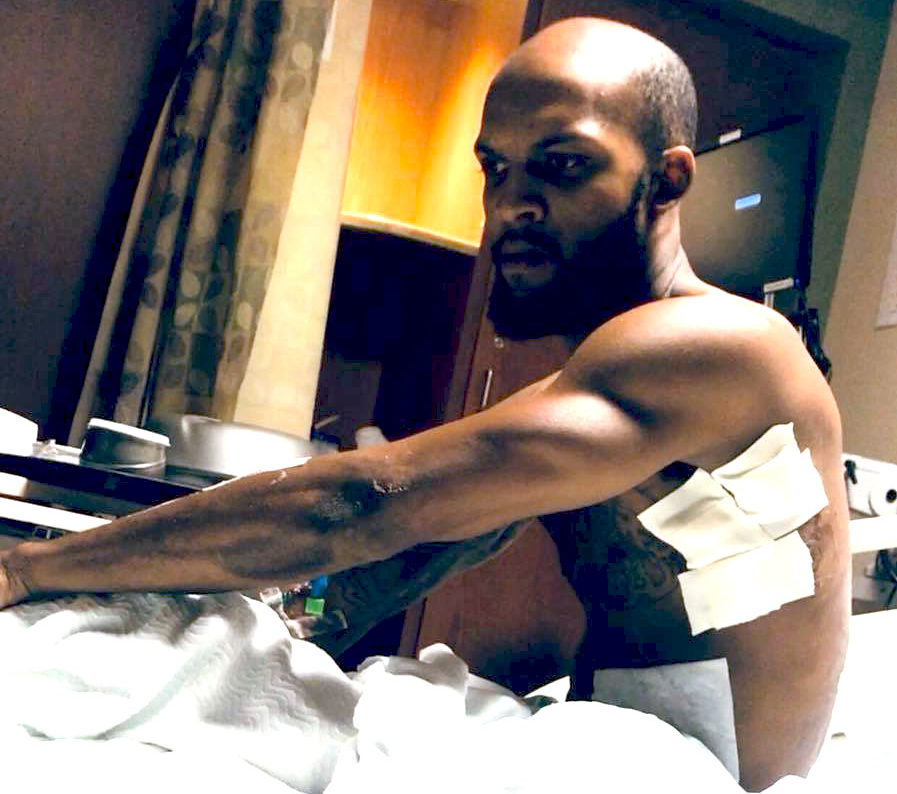 Lyndo Jones in the hospital. Jones was handcuffed to a hospital bed or nearly a week and barred from seeing his family after police shot and charged him with evading arrest.