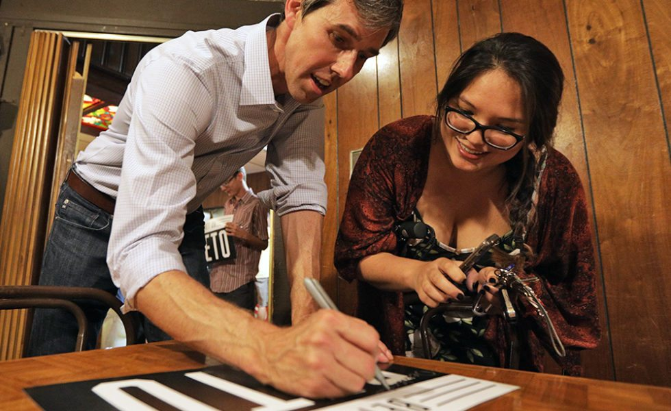 Beto O'Rourke signs a poster for Kristian Chen, from Lubbock, during a campaign stop in Lubbock in 2017.