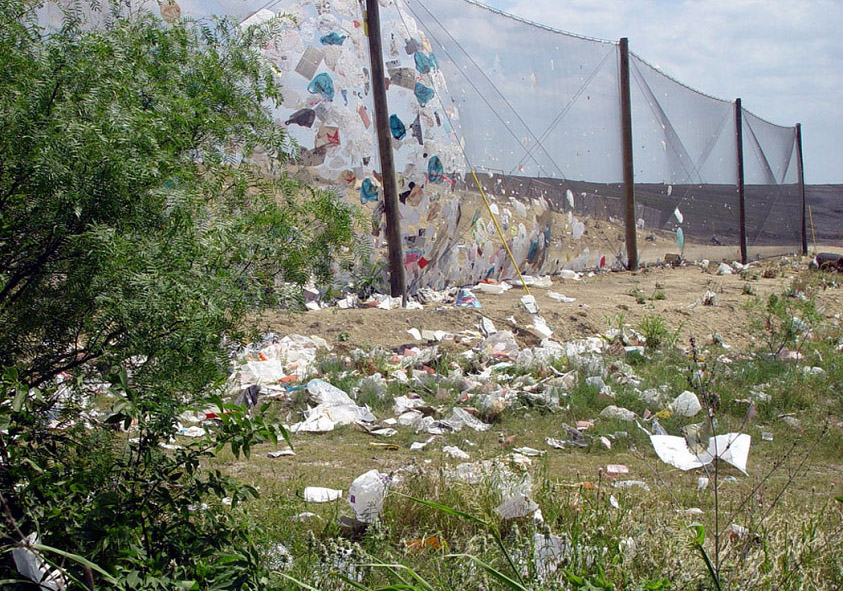 Even when plastic bags are properly disposed of, they often escape landfills during the collection process. This photo shows trash collecting around the Austin BFI Waste Management facility.