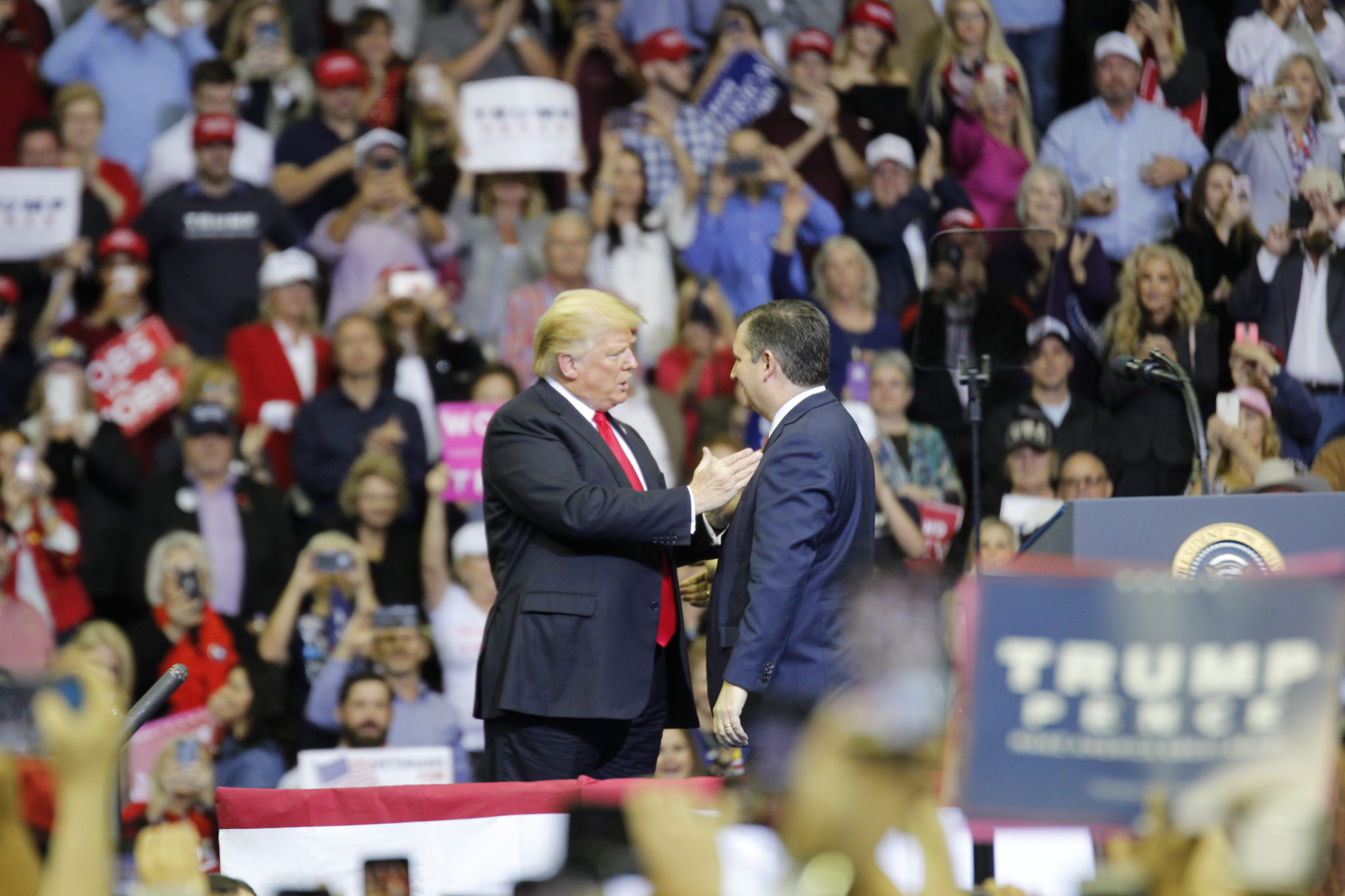 Donald Trump and Ted Cruz have a brief tête-à-tête at the MAGA rally in Houston in October 2018.