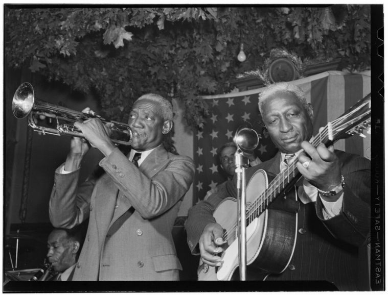 Lead Belly (right) plays with Bunk Johnson in 1946.