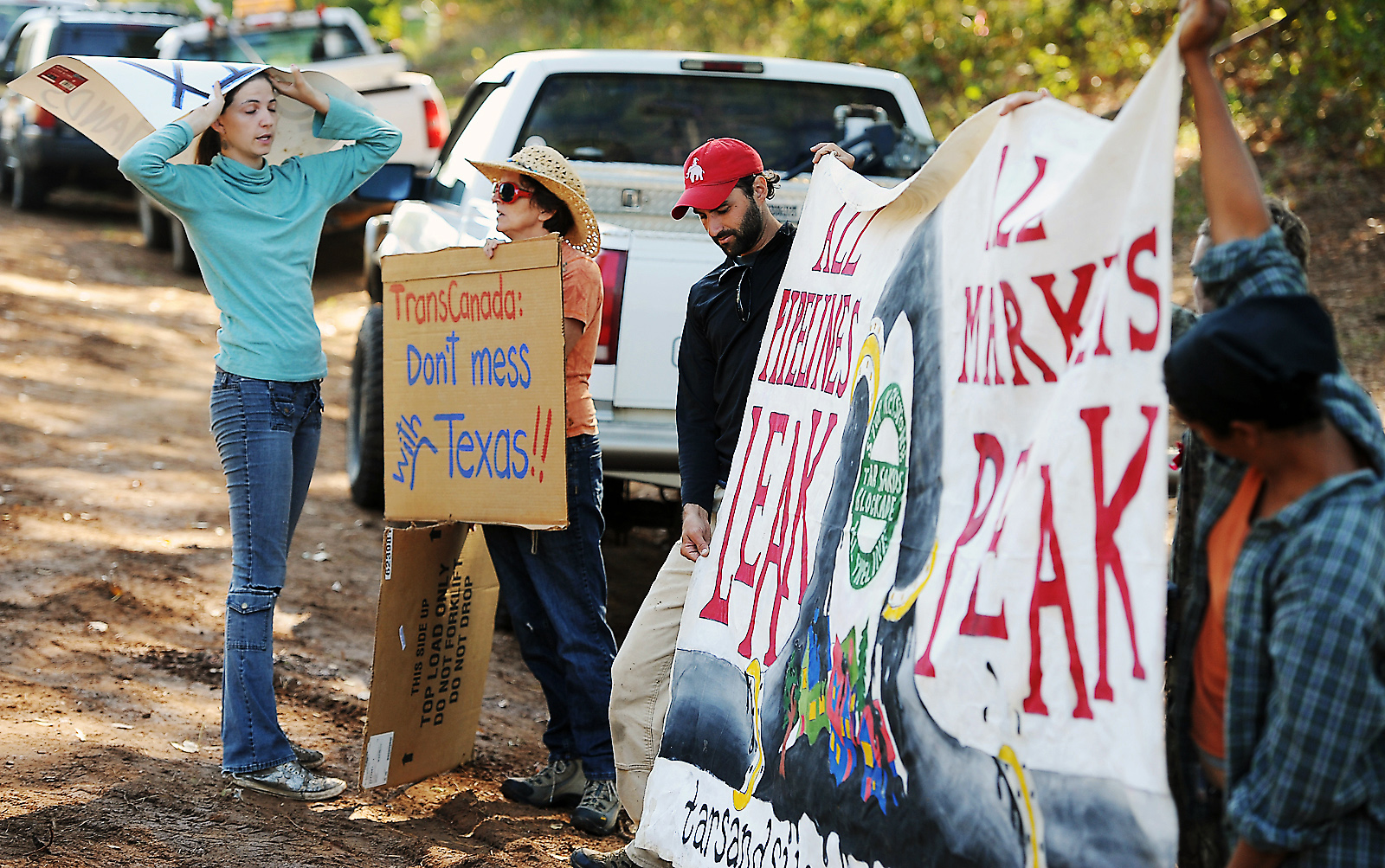 Spokesperson Cindy Spoon, left, talks with protesters at the future site of the Keystone XL/Trans-Canada Pipeline on Texas Highway 204 in 2012.
