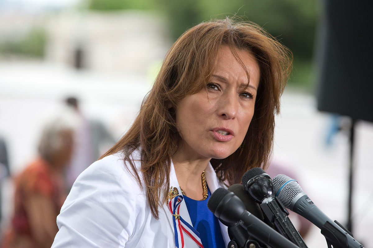 Maria Espinoza, founder of The Remembrance Project, speaks at a news conference to oppose the Senate immigration reform bill on Capitol Hill in 2013.