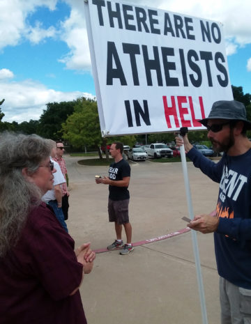 A fundamentalist protester at at the Metroplex Atheists' July event.