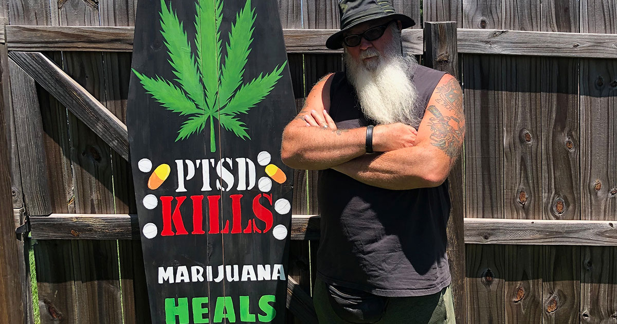 Dave Bass stands next to a military-style casket he uses at Texas Veterans for Medical Marijuana events.