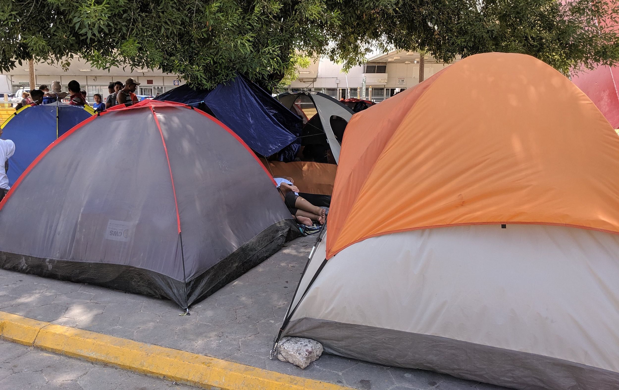 A migrant encampment by international bridge in Matamoros.