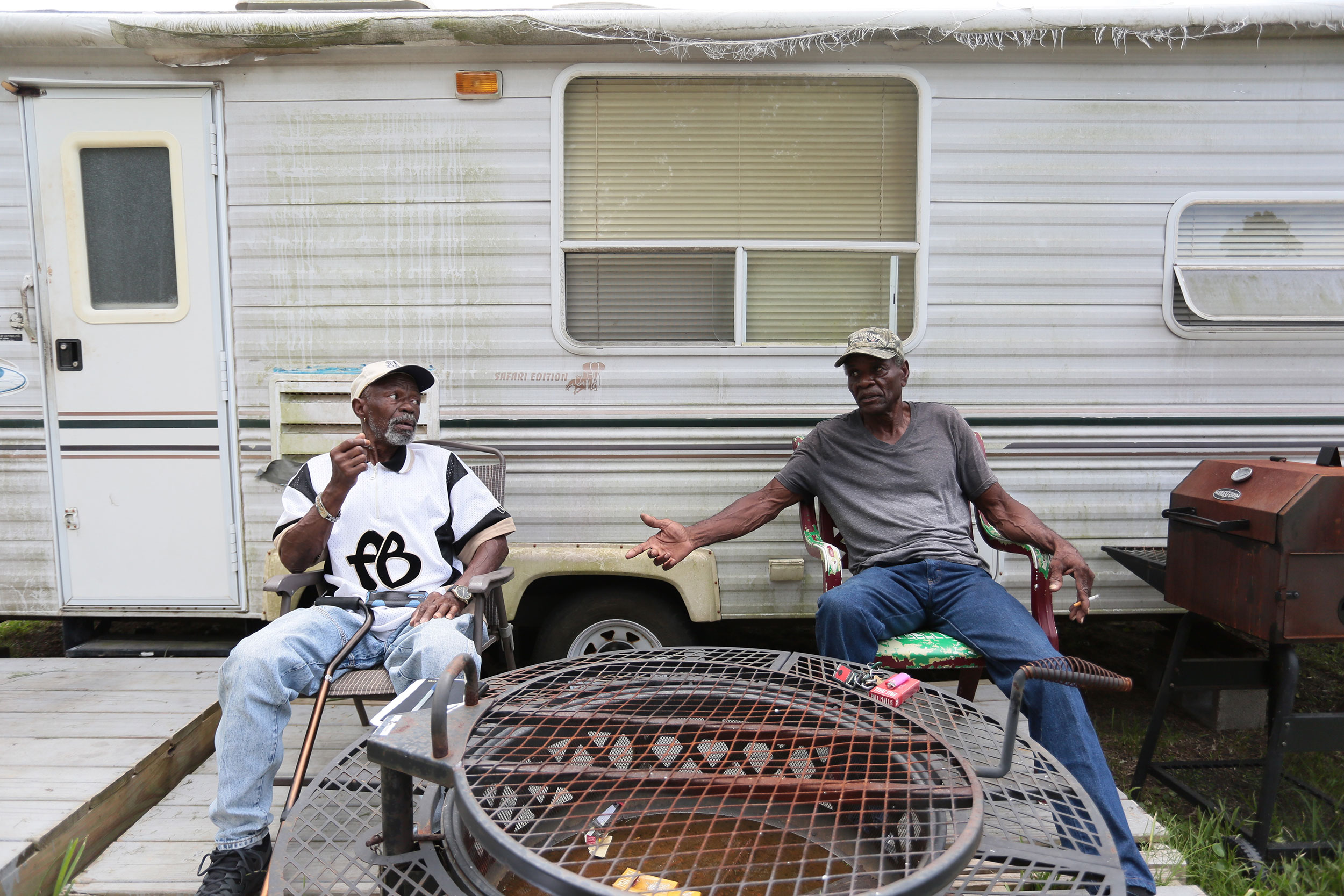 Henry Wilson, right, jacked up his storm-damaged house with his friend, Lester Owens, left. Wilson has lived in a trailer next to his house in Port Arthur for the past two years.