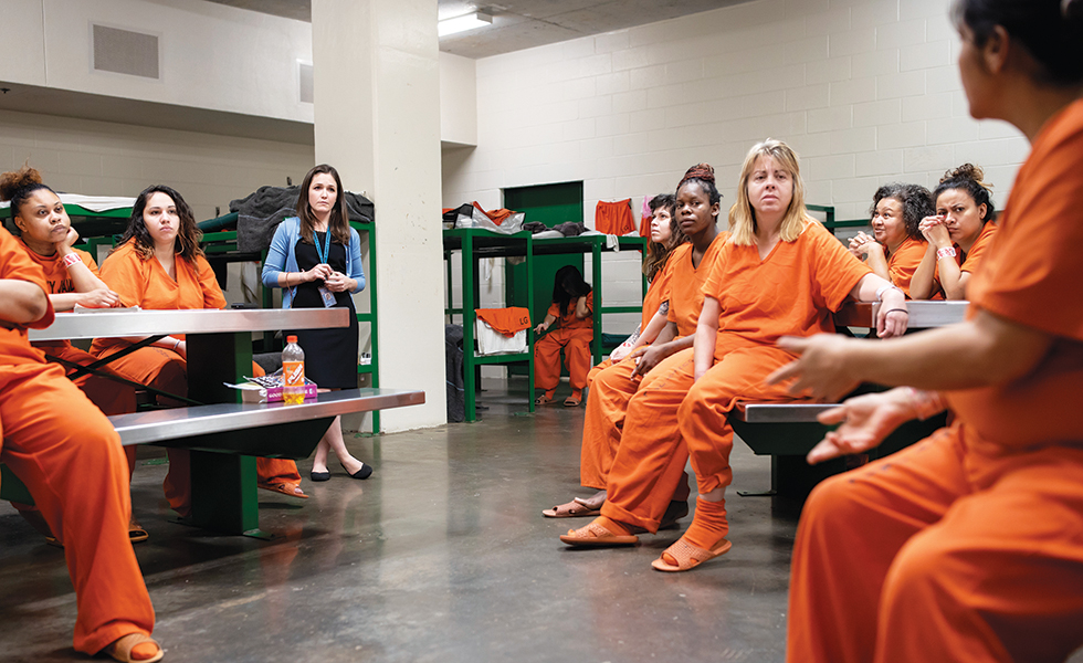After Amalia Beckner started a women's book club in the Harris County Jail, staff noted a decline in disciplinary incidents.