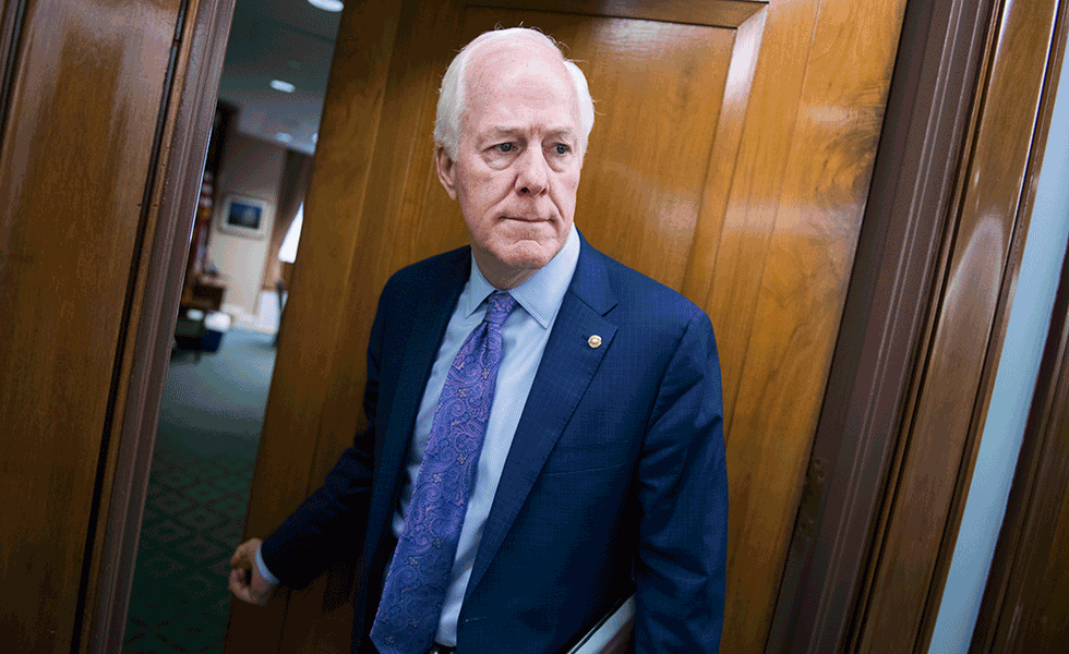Senator John Cornyn enters a Senate Judiciary Committee hearing on border security in June 2019.