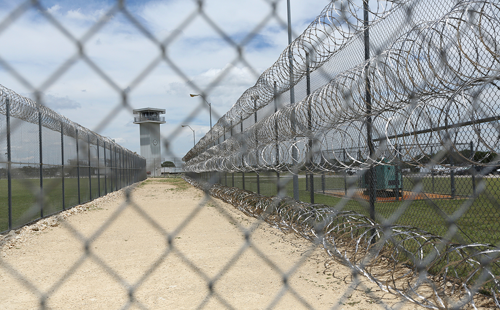 This Wednesday, June 21, 2017 photo shows barbed wire surrounding the prison that holds Jason Robinson, 39, in Gatesville, Texas. Robinson was convicted of murder at 16 and sentenced to automatic life with the possibility of parole. States are responding to U.S. Supreme Court rulings that have found mandatory life-without-parole sentences unconstitutional for juveniles except for the rare homicide offender incapable of rehabilitation. After the latest ruling in January 2016 said those serving such terms must have a chance to argue for release one day, dozens of inmates have won new sentences — and some, freedom — while others wait or fight to have their sentences reviewed. (AP Photo/Jaime Dunaway)